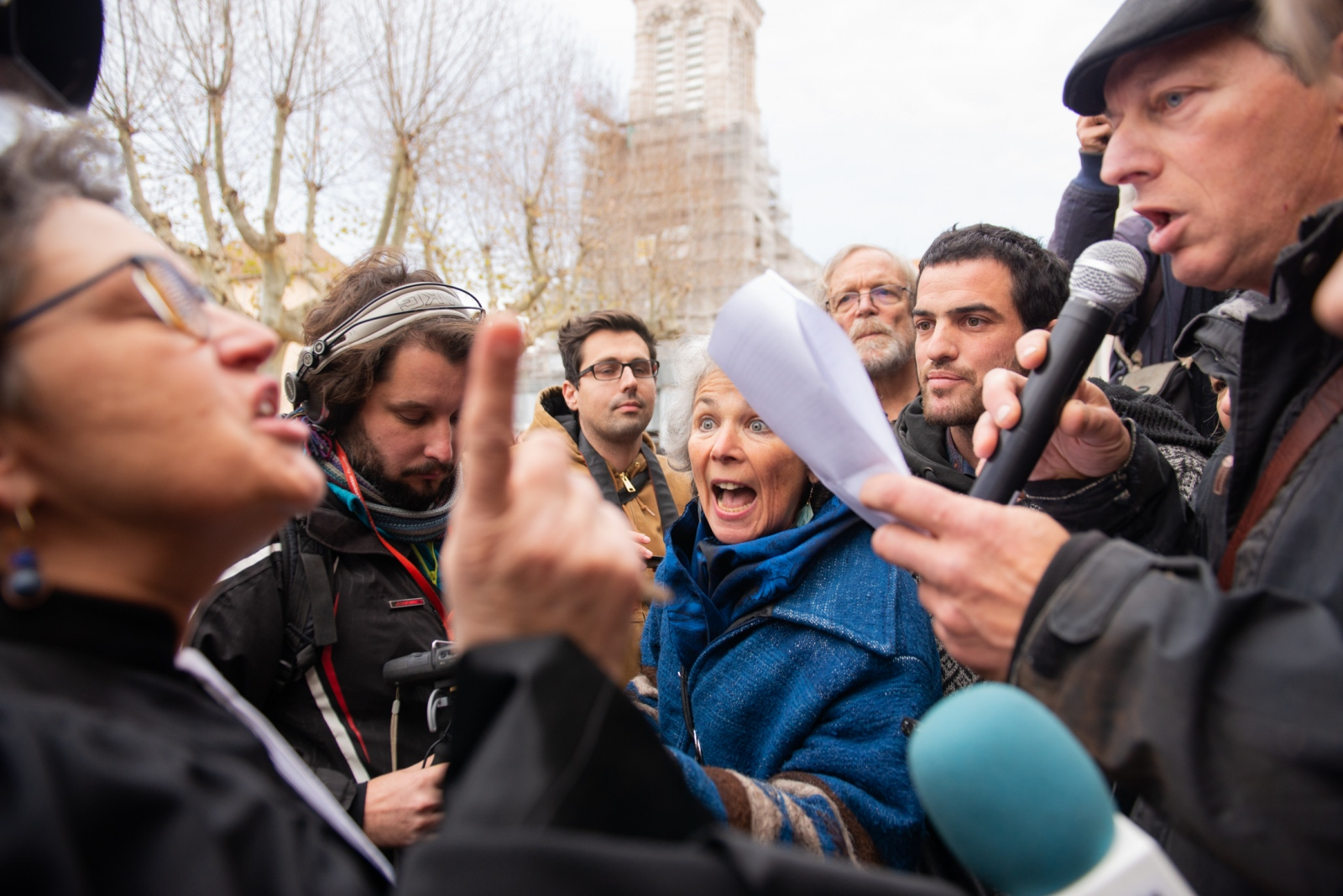 The judge (L) had just condemned the 3+4 group for supposedly helping migrants cross the border into Italy during an anti- far-right march. She walked out into the street while one of the condemned, Benoit, was giving a speech to supporters. Gap - France. December 13, 2018.