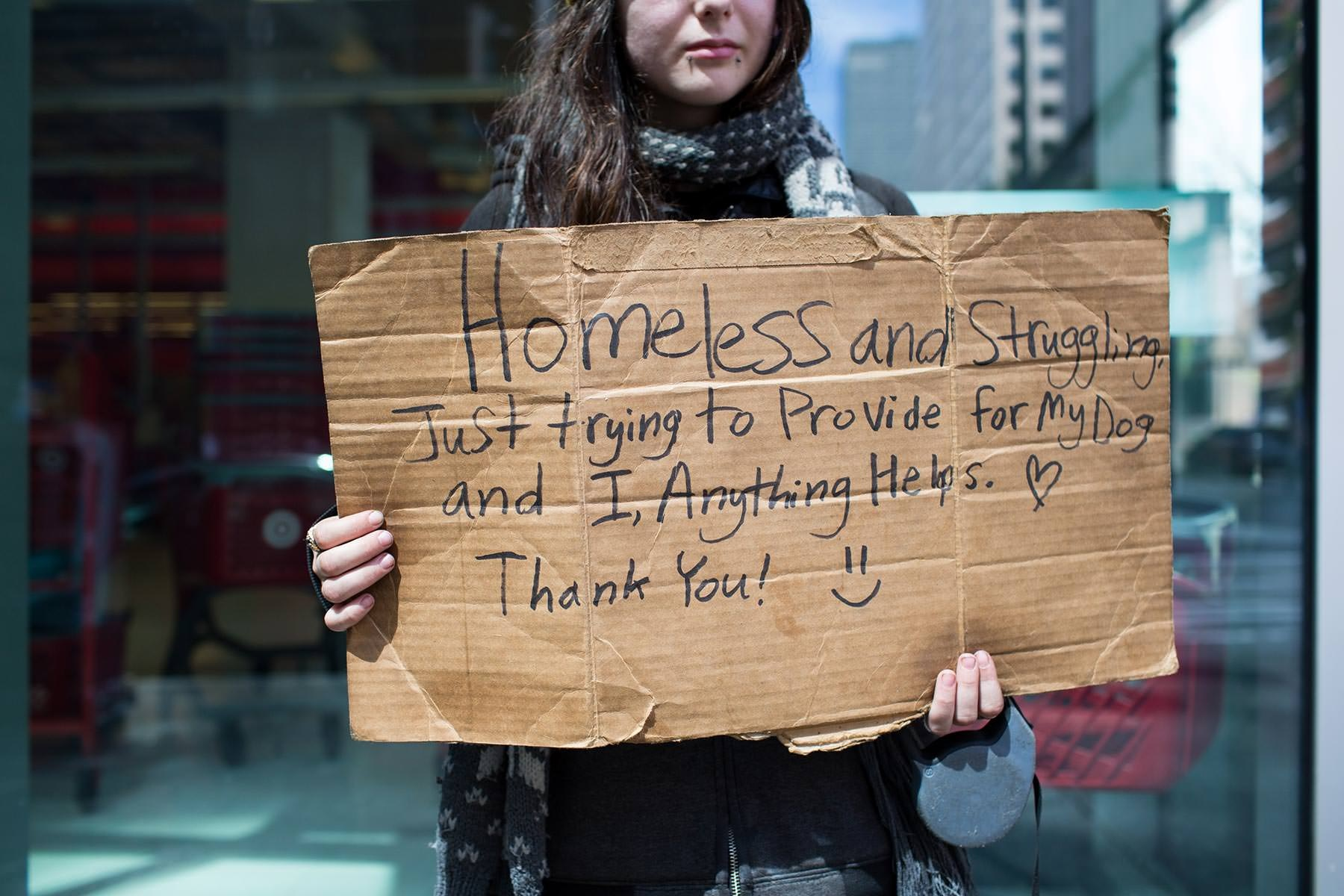 Heather begs for money to feed her dog Poppy in downtown Seattle. 'Homeless people on their pets'  for the Guardian