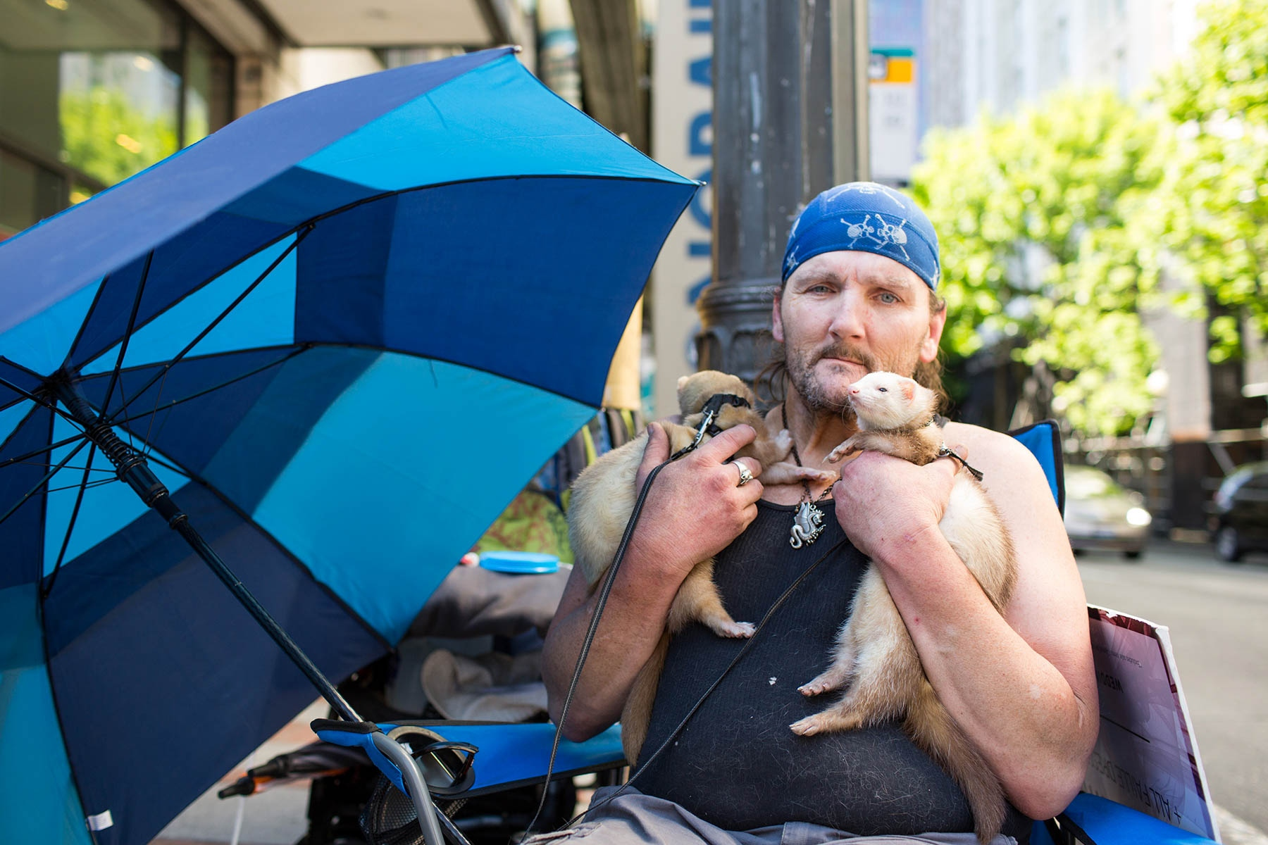 Richard Dyer with his pet ferrets Ricky and Tiny in downtown Seattle. 'Homeless people on their pets'  for the Guardian