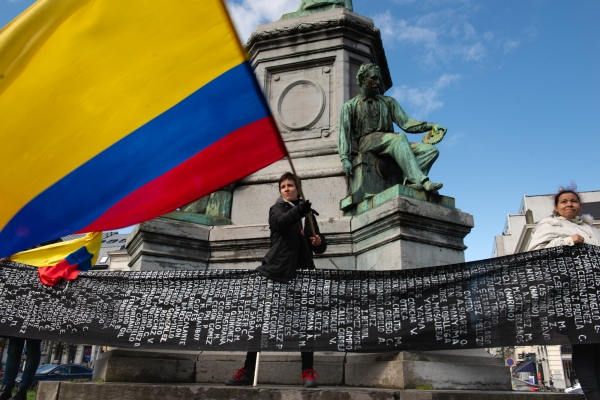 The Colombian flag is being swung by one of the organizers of the march from Paris to The Hague demanding justice and peace for the death of social leaders and human rights defenders. Brussels, Belgium - April 3, 2019.