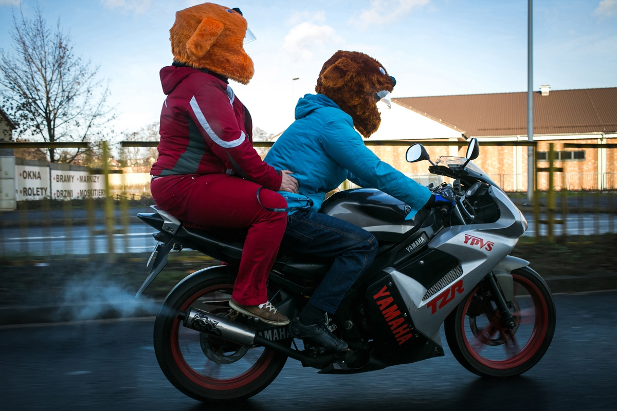 Agnieszka and Honorata riding through the streets of Kalisz, on the first day of Christmas. The bike would be stolen not long after.  Kalisz, Poland 2015