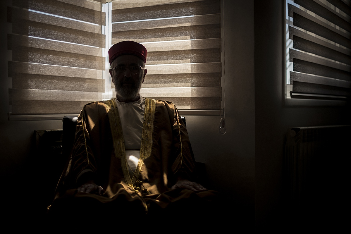 One of the Samaritan priests waiting at his house. In a few minutes he will go to the synagogue to pray. Yom Kippur day.