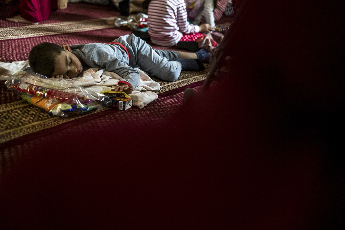A child is asleep inside the synagogue at the end of the Yom Kippur  day.