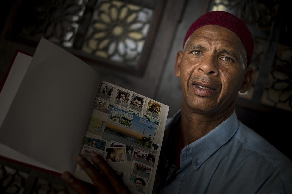 This man, who converted to Islam several years ago, shows his collection of stamps of Che Guevara.