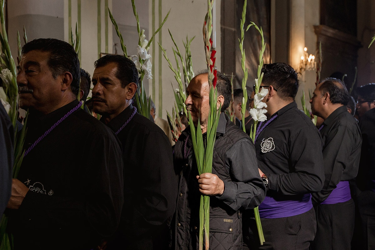 To join the Brotherhood, members pass through a yearlong trial where they prove their devotion to Jesus of Nazareth by attending events like masses and processions.