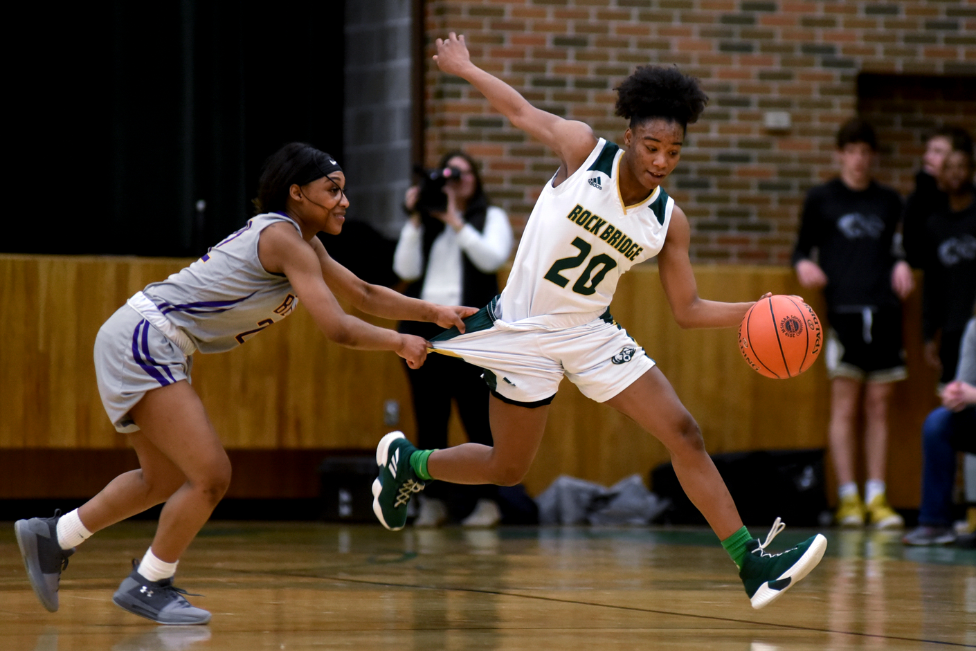 Belton High School senior Danielle Faulkner grabs on to Rock Bridge High School junior Sanaa' St. Andre's shorts Friday at Rock Bridge High School. The Bruins will face Lebanon High School on Wednesday in Sedalia.