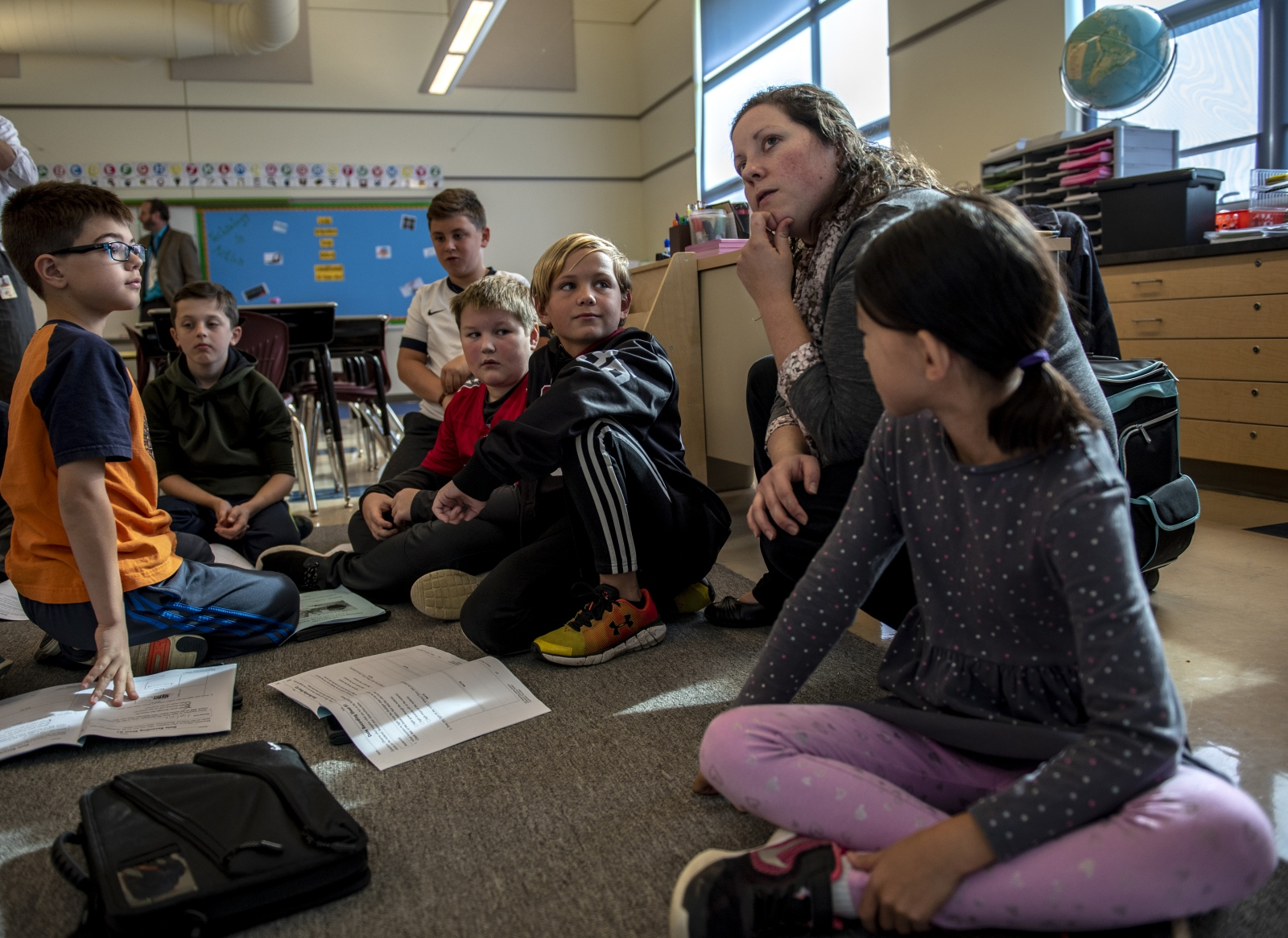 Tara Pollick answers her students' problems in the STEM class on Oct. 17, 2018, at Ferguson Township Elementary School in State College, Pa.