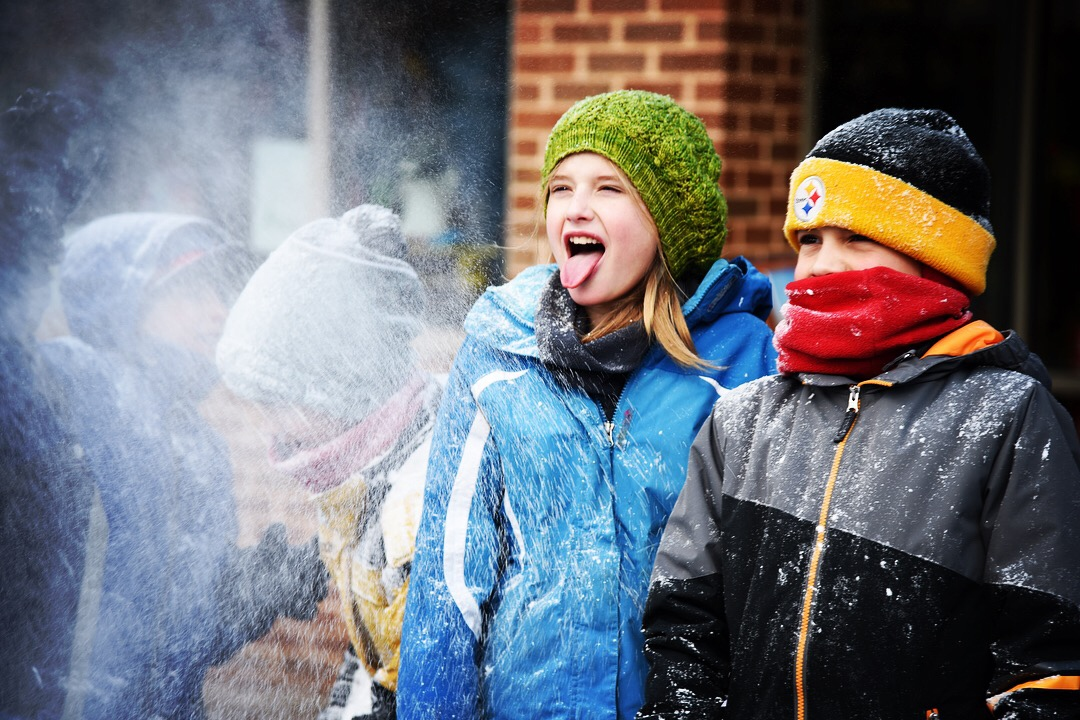 Children play with ice at an ice sculpture activity at First Night State College on Dec 31, 2017.