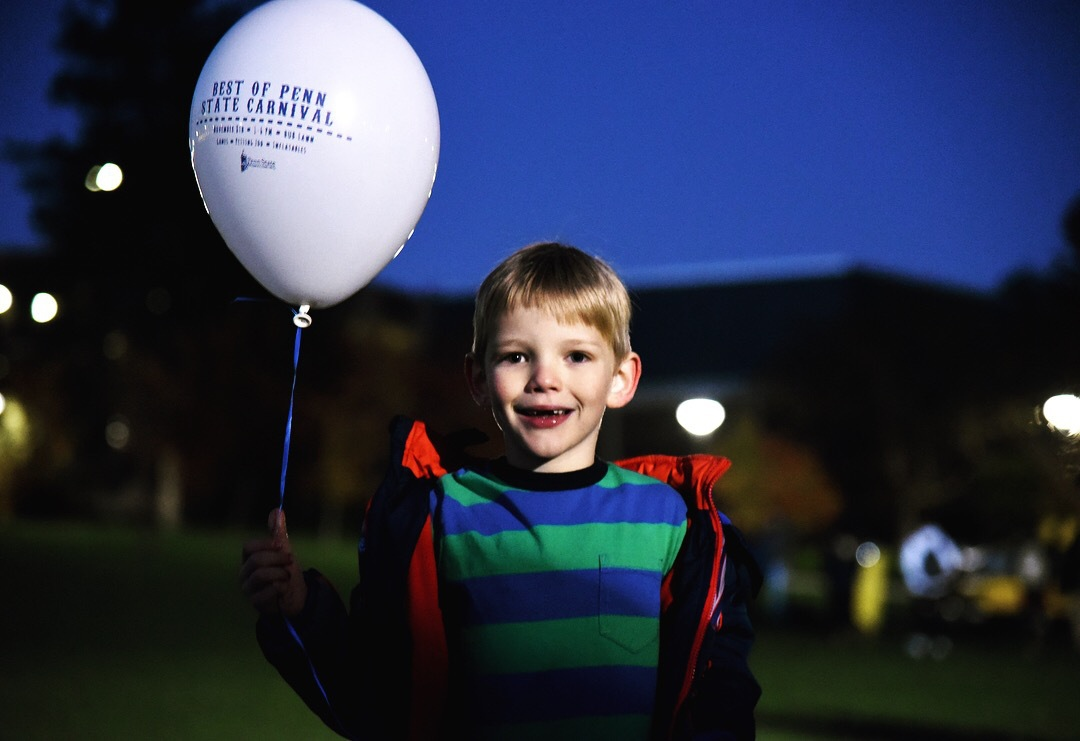 A little boy holds a balloon at Penn State Carnival on Nov 13, 2017.