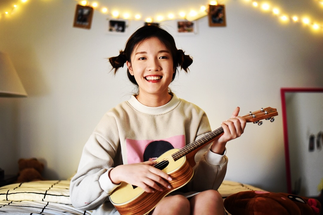 Yuki Yang, as a ukulele lover, plays her ukulele in her bedroom in Jan 2018, in State College, PA.