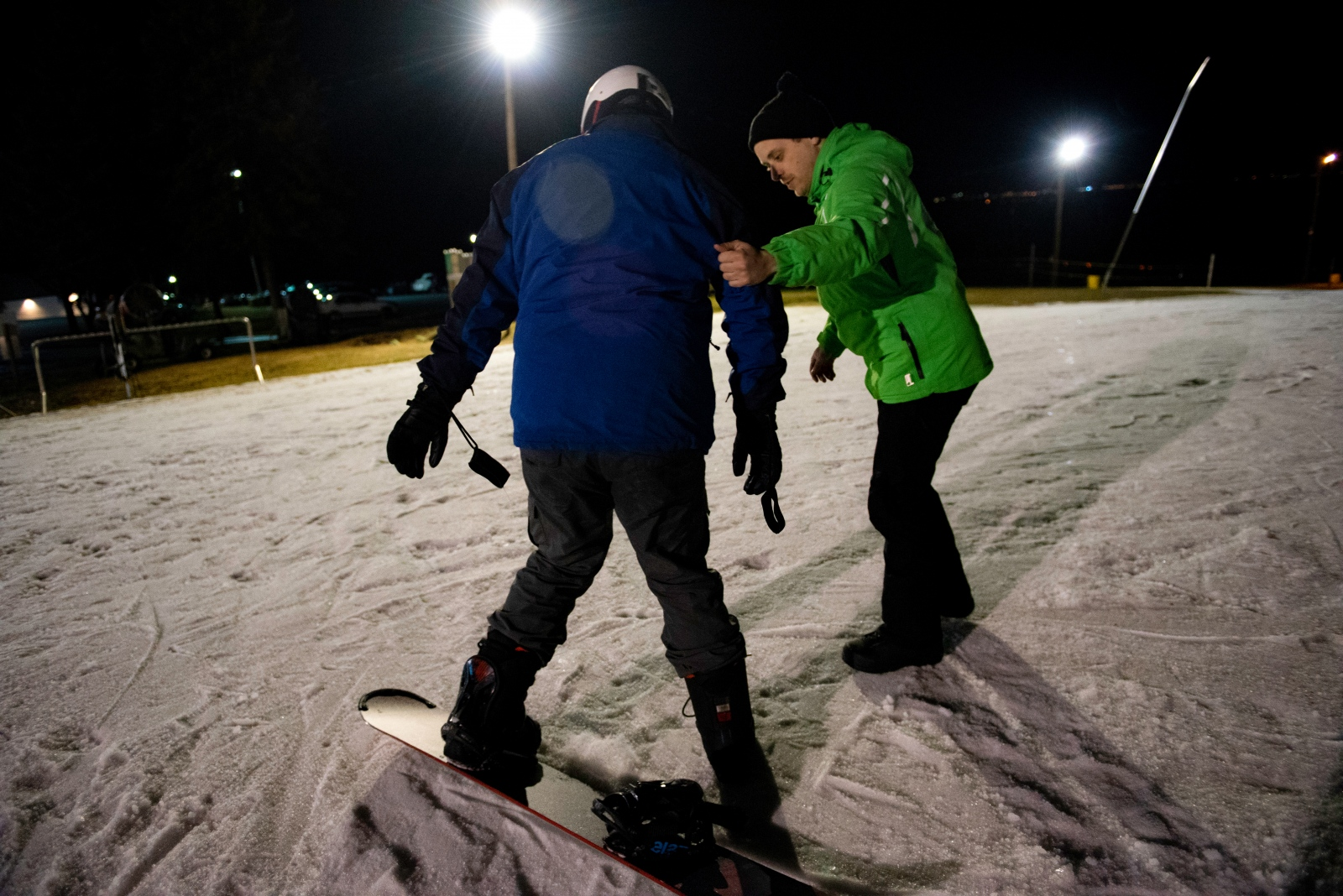 Christophe Cheroret helps his student Jim Zhang keep balance during the snowboarding class Monday, Feb 26, 2018, at Tussey Mountain in State College. Cheroret said he enjoyed teaching students a lot.