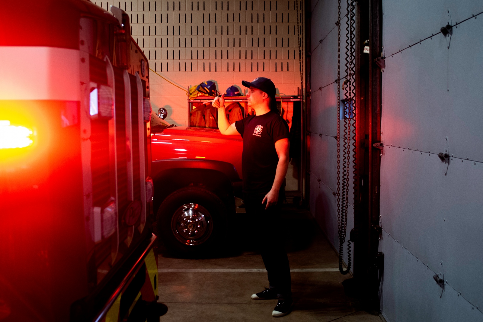 Christophe Cheroret checks the red light of a fire truck at Firehouse, Monday, April 9, 2018, in State College.