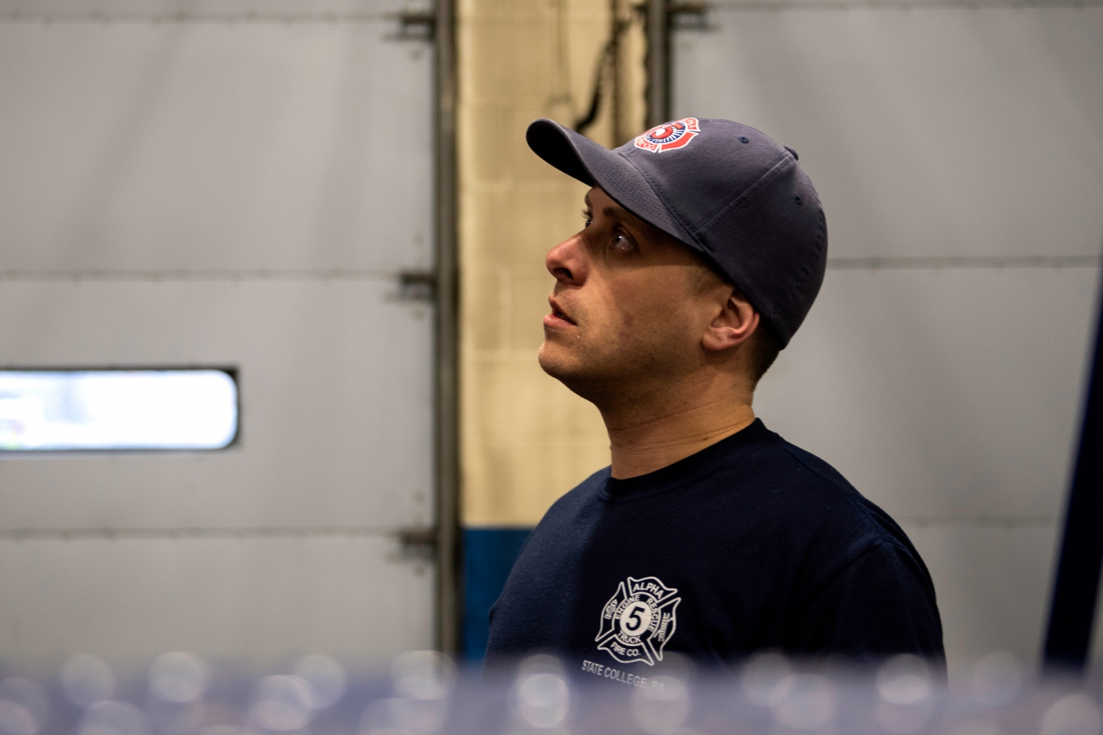 Christophe Cheroret listens to his colleague talking about an error happened on a fire truck at Firehouse, Monday, April 9, 2018, in State College.