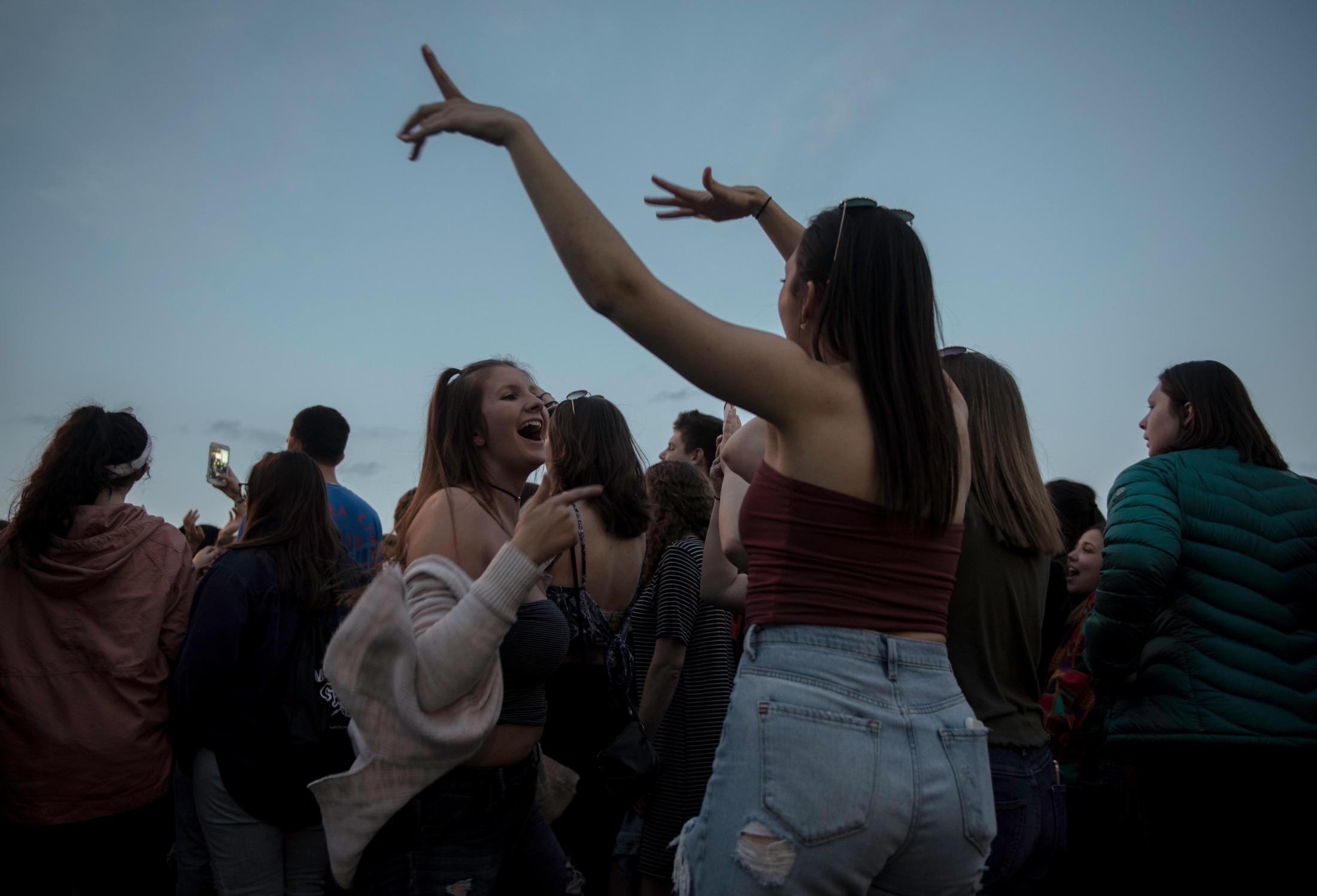 Two girls dance with the music  On Concert at Penn State University, in State College, PA, on April 27, 2018.