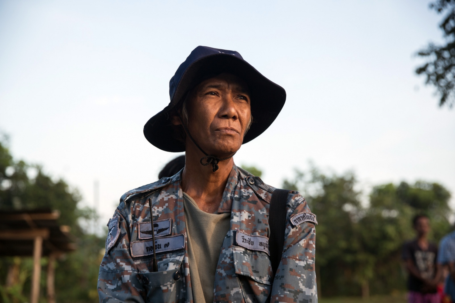 A community member of Klong Sai Pattana community stands in line during the morning role-call. The village is part of the Southern Peasant Federation of Thailand (SPFT) and has fought for a community land rights title for the last decade. Whilst the community is close to achieving its goal they remain alert and prepared for any eventuality having already seen 4 of their community members killed during their struggle.  Surat Thani Province, Thailand