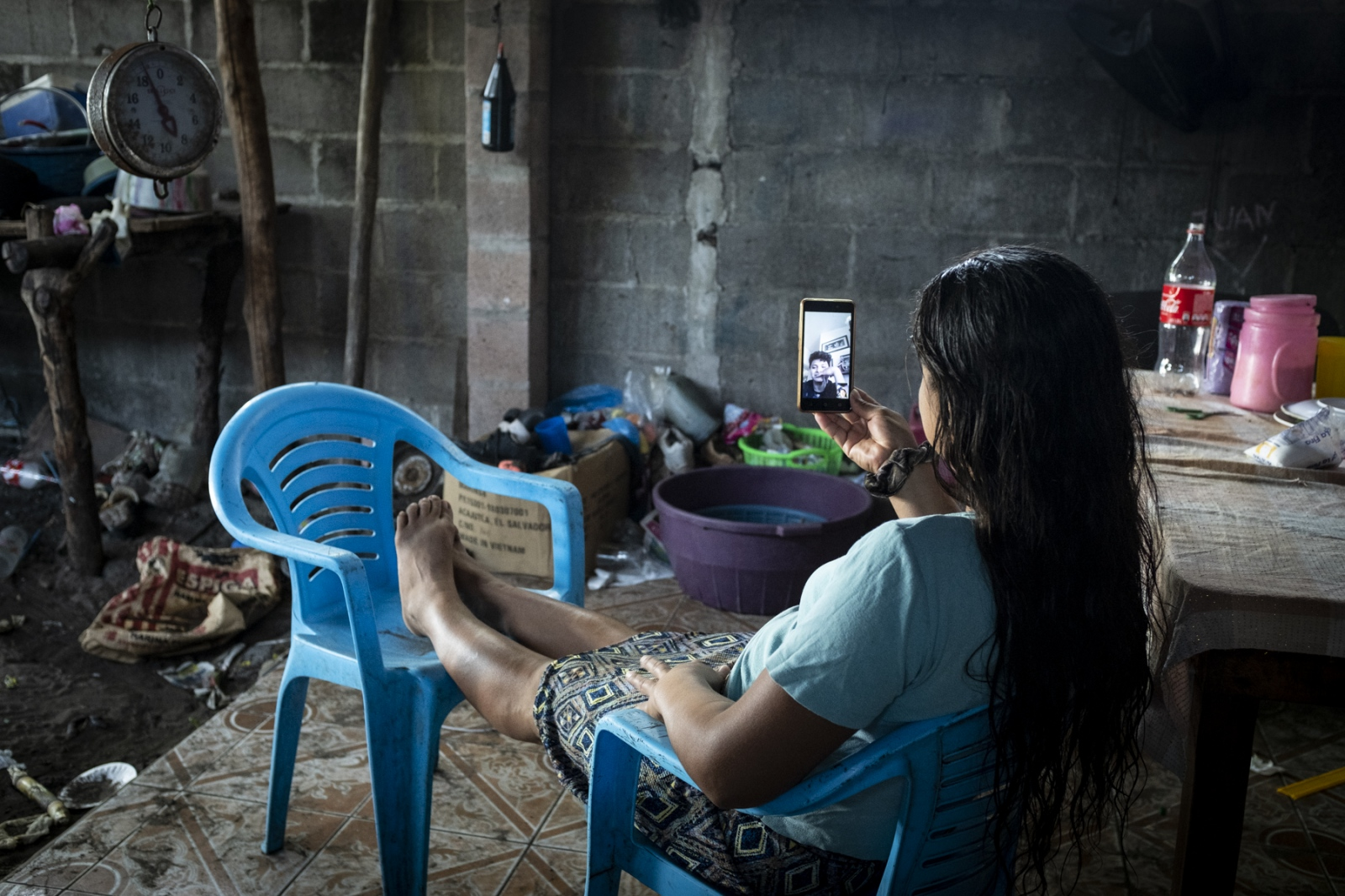 Beatriz Elias, 35, speaks with her son Juan Carlos, who migrated from his coastal community of La Barra de Santiago, El Salvador to the United States last November. They talk only on weekends, when Juan Carlos is off from his job as an electrician, from which he makes $14 per hour.