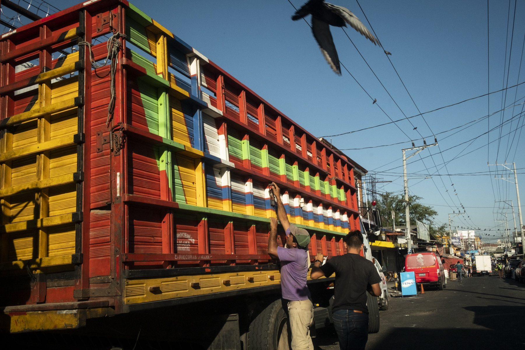 Men unload a truck transporting produce from El Salvador's rural areas at the Central Market in San Salvador.