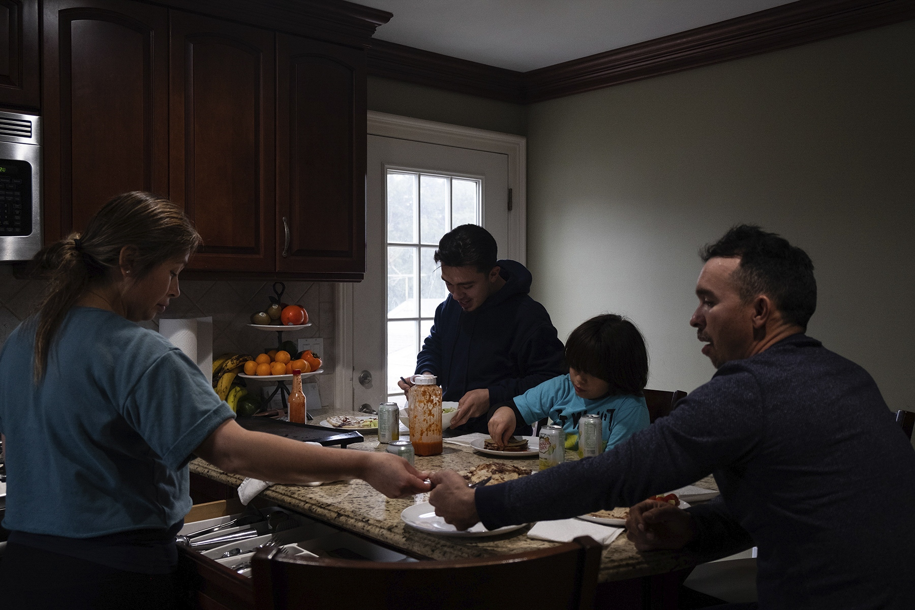 The Villalobos family gathers for lunch on Sunday afternoon, their only day off work. While Erik helps his father with his landscaping business, his mother, María Villalobos, works as a florist in a local shop.