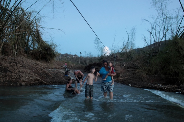 Destroyed bridge imperils village cut off by Hurricane Maria