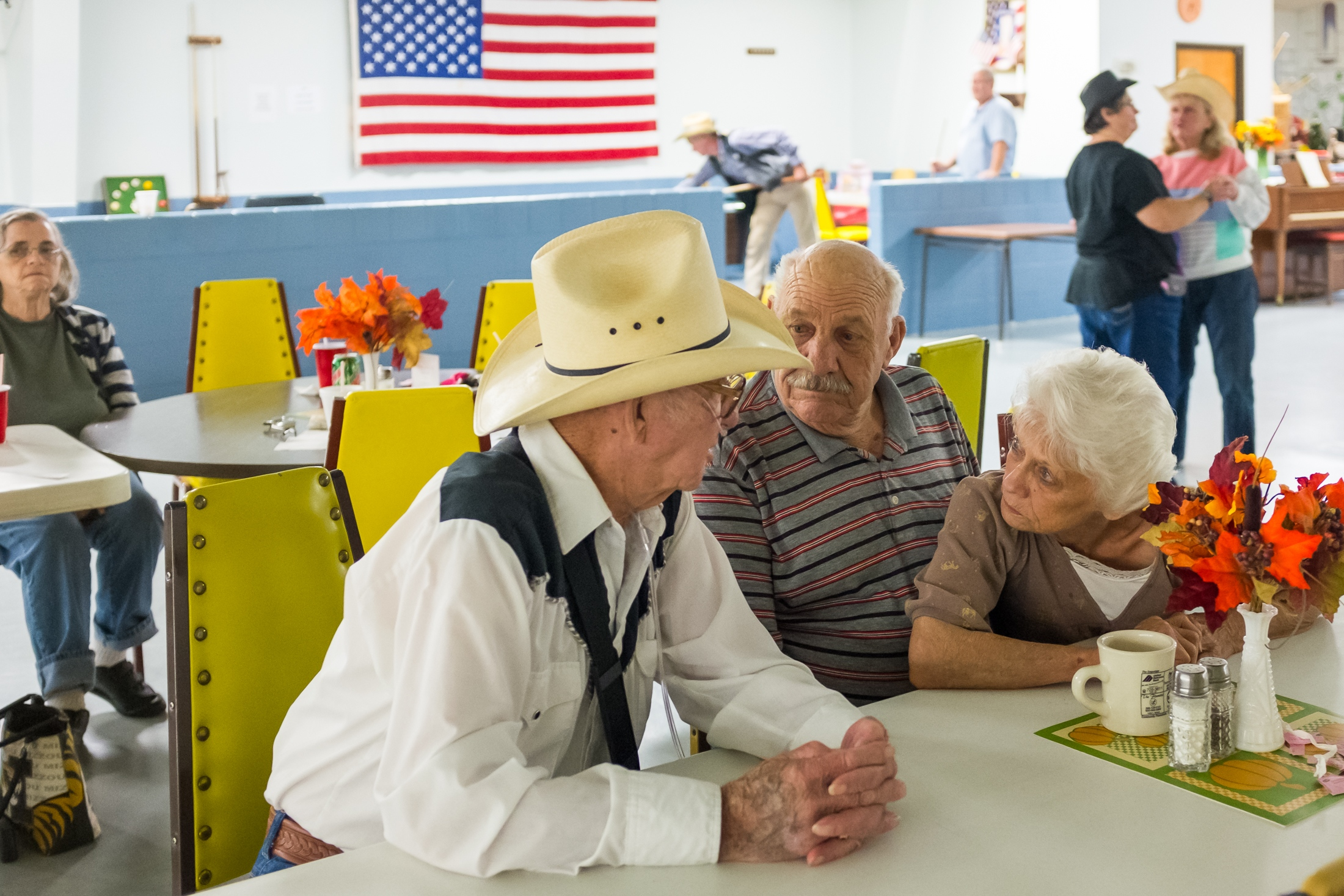 Jay enjoys a conversation with his friends during his regular visit to the Trenton Senior Center.