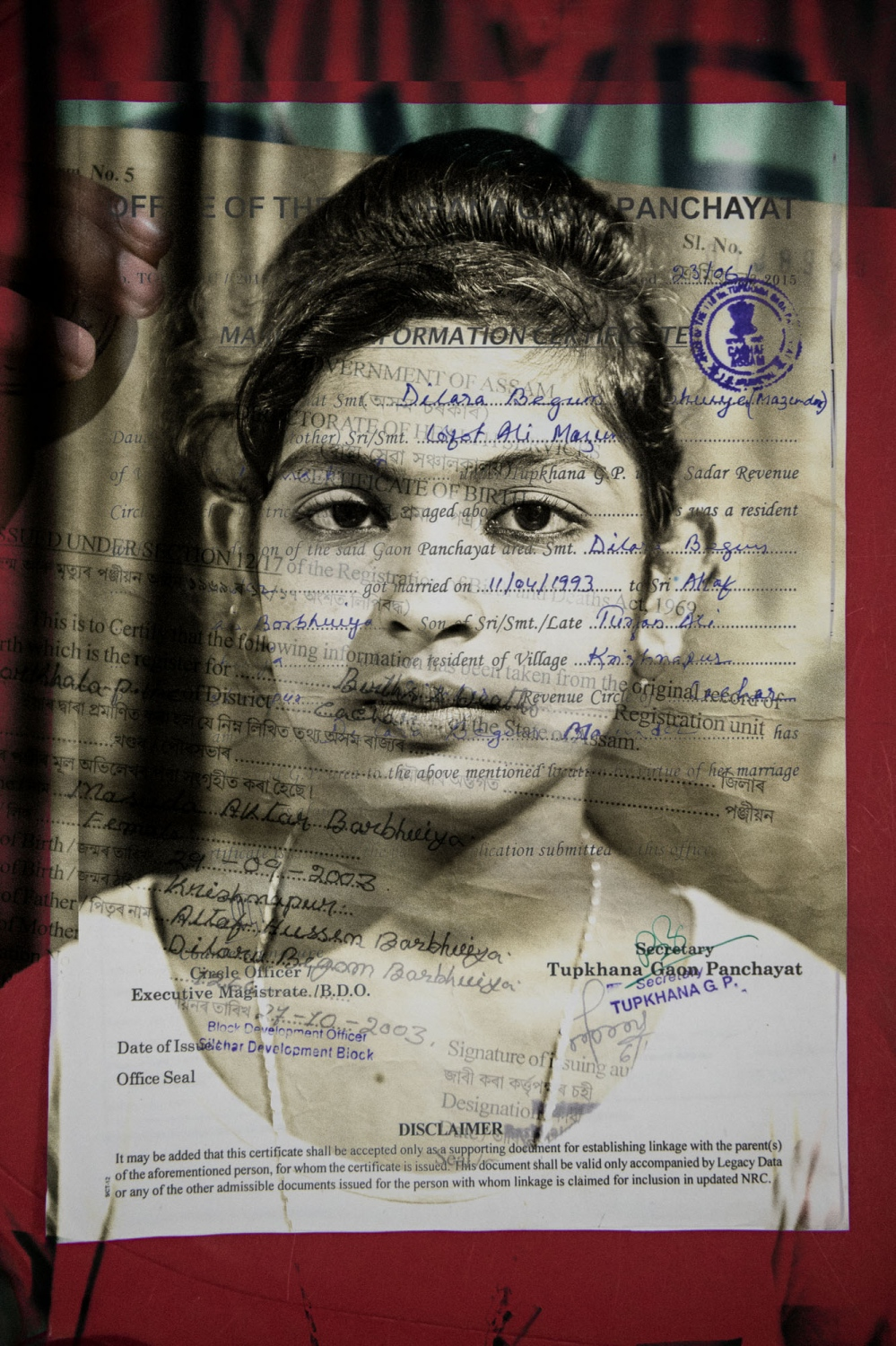 Nasuda Aktra Barbhuiya, 14 years old. She and her mother are not in the NRC list, but the rest of the family is. They have provided her birth certificate as proof, but it is not accepted. Her mother's name has been left out due to a misspelling of her name on her marriage certificate. It is common that only one or two members of a family are excluded from the list, often for no obvious reason, or simple errors such as a misspelling.
