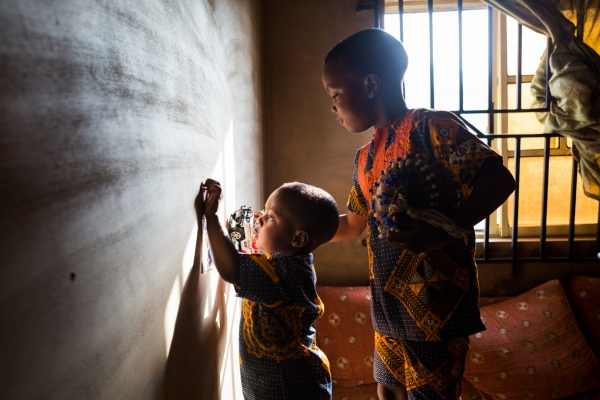 Zainab's kids, Mohamed and Muaz, share a moment in their home in Ibadan.