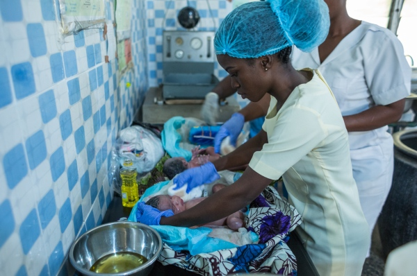 Nurses clean twin babies minutes after their delivery in Adeoyo maternity hospital, Ibadan.