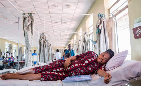 A pregnant woman writhes as she waits to be taken to one of the labor wards at the University College Hospital, (UCH) Ibadan