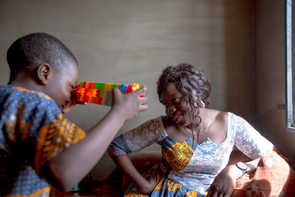 "Mohamed uses his carefully constructed lego to ""photograph"" his mother in their living room. Mohamed, 6 is Zainabs first child.Shortly after giving birth to him, Zainab haemorrhaged and with the advice of a Doctor in UCH, Ibadan she agreed to take Tranexamic acid. Zainab is convinced that if she did not agree to take the Tranexamic acid, she would have died"
