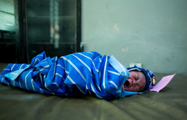 New born baby boy cries as he rest in the delivery room at Adeoyo maternity hospital, Ibadan.