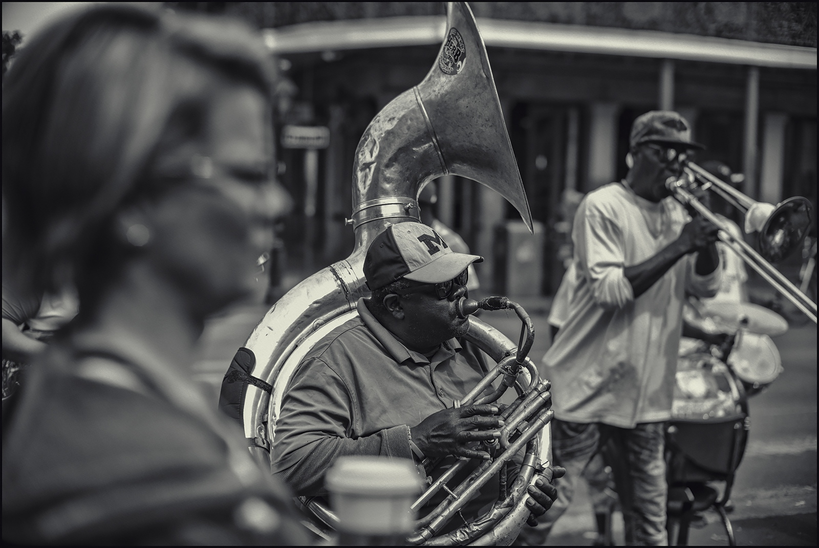 Brass band performing outside French Market. New Orleans, LA. 2019.