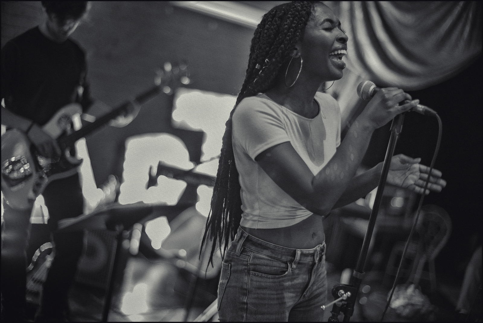 """Chaia"" Dent, student in contemporary & modern music at Loyola University performing at ""Art Garage"" in the ByWater district of New Orleans. 2019."