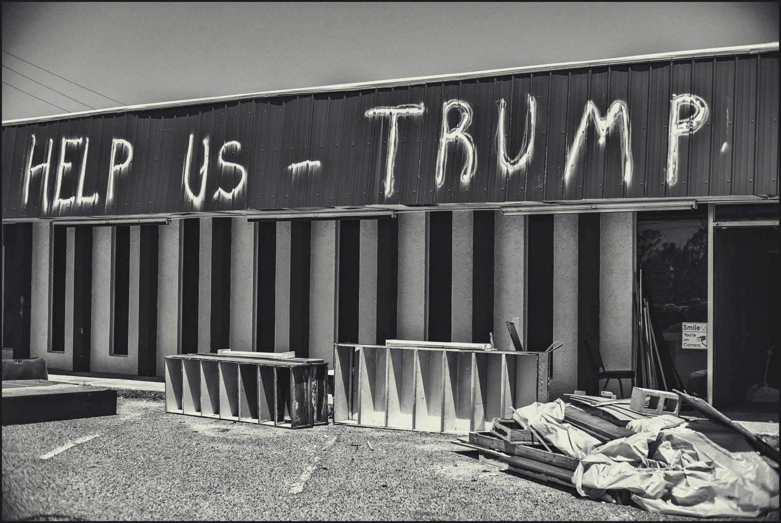 In Tyndall.damaged store front with message to Trump, Hurricane Michael. Florida.. 2019.