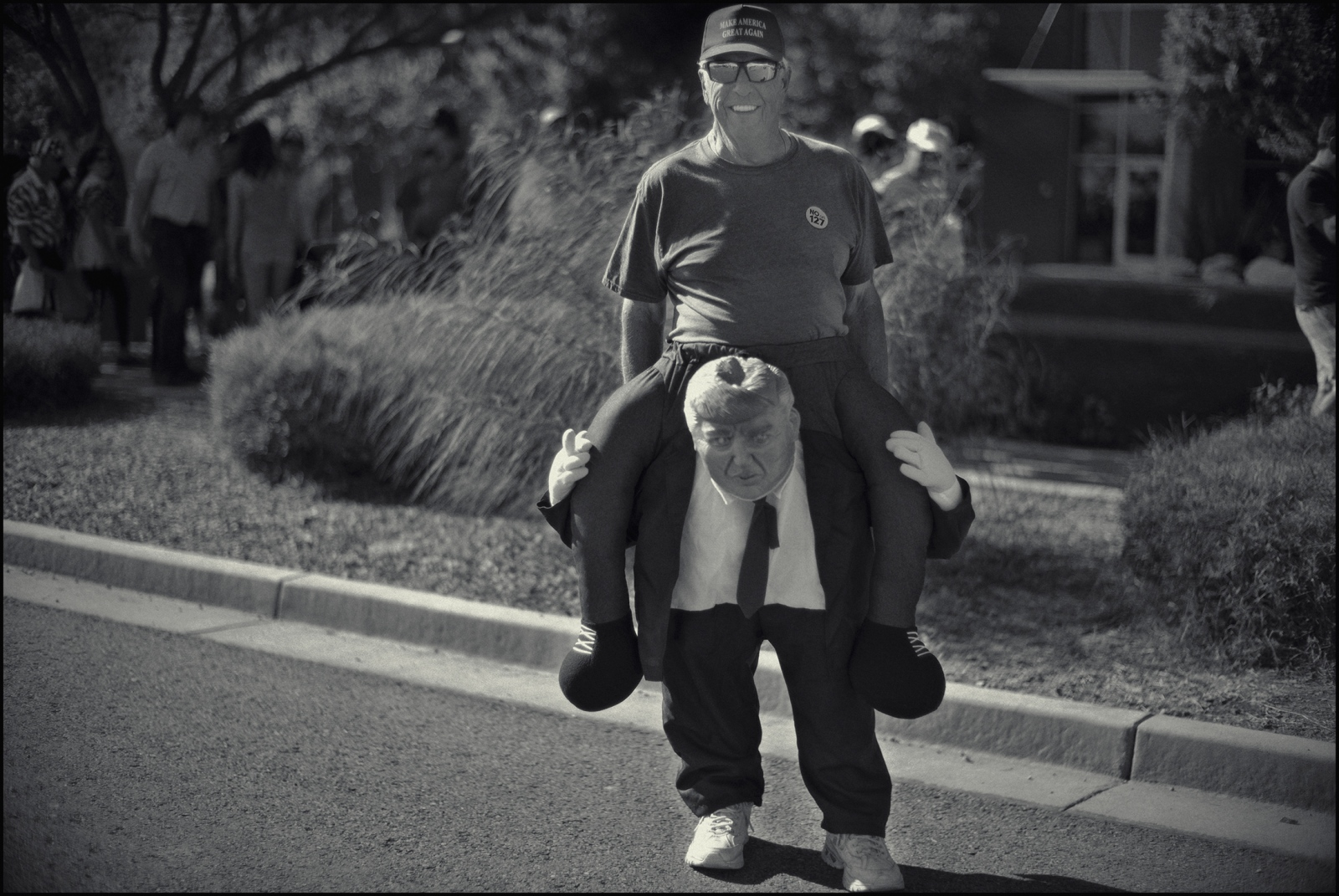 Supporter rides Trump. Political rally, Mesa, AZ. 2018.