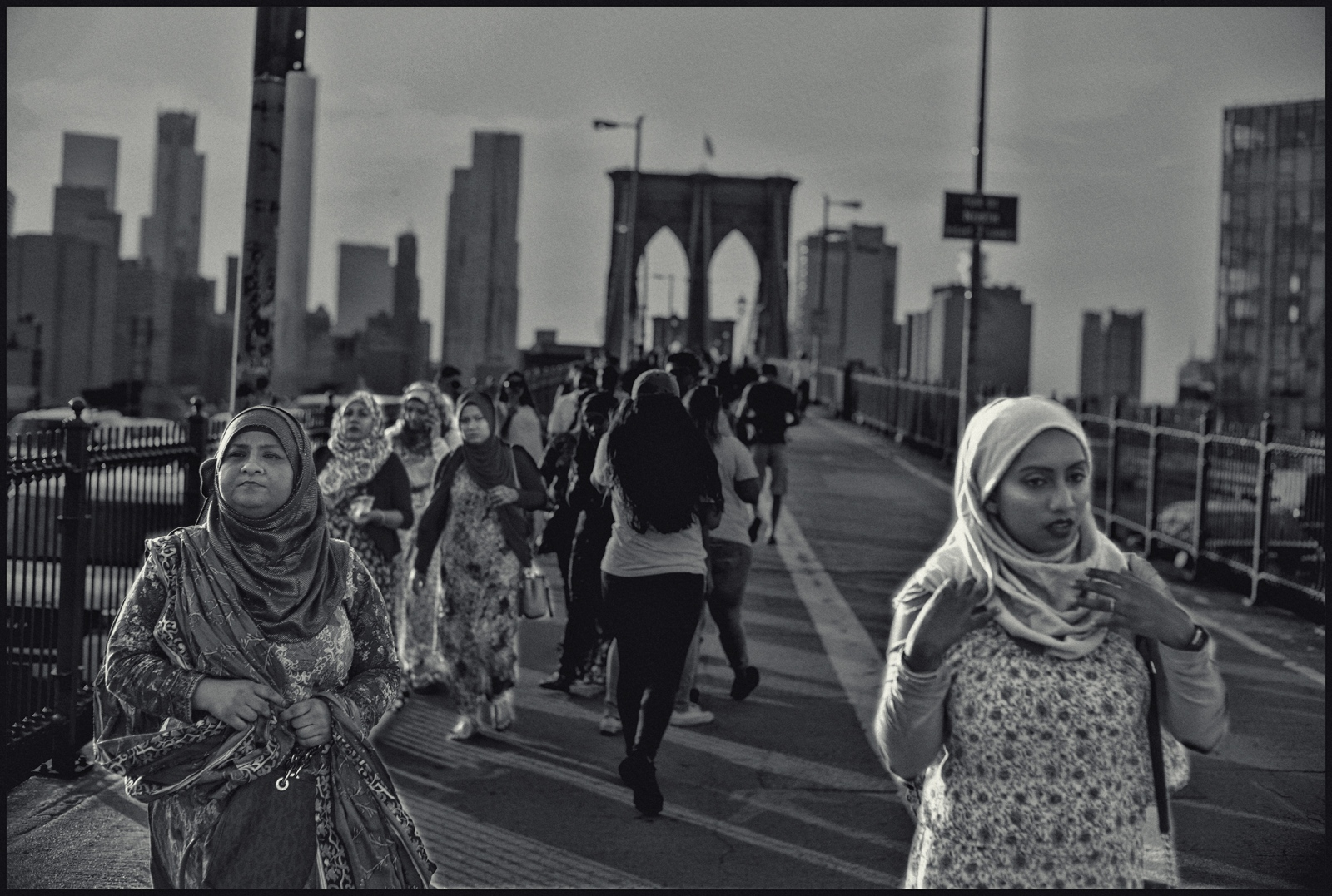 Extended immigrant family visiting the Brooklyn Bridge. Brooklyn NYC. 2017.