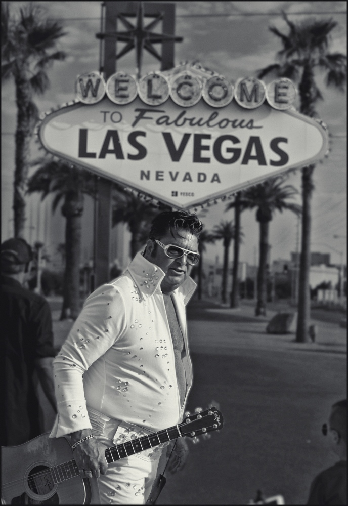 """Mark 702"" Elvis impersonator at ""Welcome to Fabulous Las Vegas"" sign. Labor day. 2018."