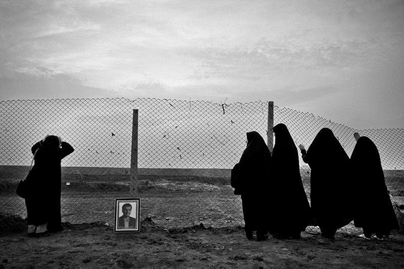 Each year, nearly two million people travel to war-torn areas of the war between Iran and Iraq. The people of Iran believe that these areas are holy because of the blood of the Iranian martyrs who were killed in the war. Many of them are families of martyrs and travel to those areas to pray and mourn for their martyred family members. Shalamcheh is a border area between Iran and Iraq and is one of the first regions that was attacked by Saddam Hussein, the Iraqi dictator. It was destroyed during the war and thousands of soldiers were killed in this region. . Women are crying in the shalamcheh area for Iranian martyrs. Ahvaz city, Shalamcheh border