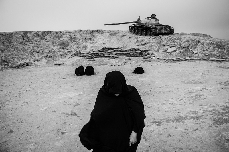 """Each year, nearly two million people travel to war-torn areas of the war between Iran and Iraq. The people of Iran believe that these areas are holy because of the blood of the Iranian martyrs who were killed in the war. Many of them are families of martyrs and travel to those areas to pray and mourn for their martyred family members. Shalamcheh is a border area between Iran and Iraq and is one of the first regions that was attacked by Saddam Hussein, the Iraqi dictator. It was destroyed during the war and thousands of soldiers were killed in this region. Women are crying in the shalamcheh area for Iranian martyrs. From my long-term project """"War is Still Alive"""". ."""