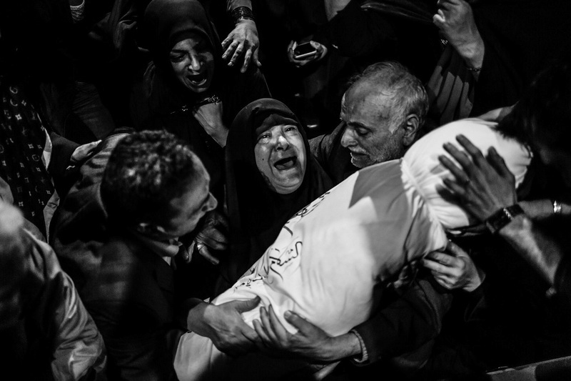 """Ezzat (64) a mother who waited 30 years for news, meets the body of her son, Hamid Saeedi, who was 18 years old when he went to war. Tehran The war between Iran and Iraq started on September 22, 1980, with iraq's massive aggression against Iranian territory. The war lasted eight years and more than 220,000 Iranian soldiers were killed. The war, identified as the longest conventional conflict of the 20th century, ended in July 1988, after the two countries accepted UN resolution 598. After the war, it was revealed that the bodies of over 10,000 Iranian soldiers were missing and there is still no sign of them. from my long-term project """"mothers of patience""""."""