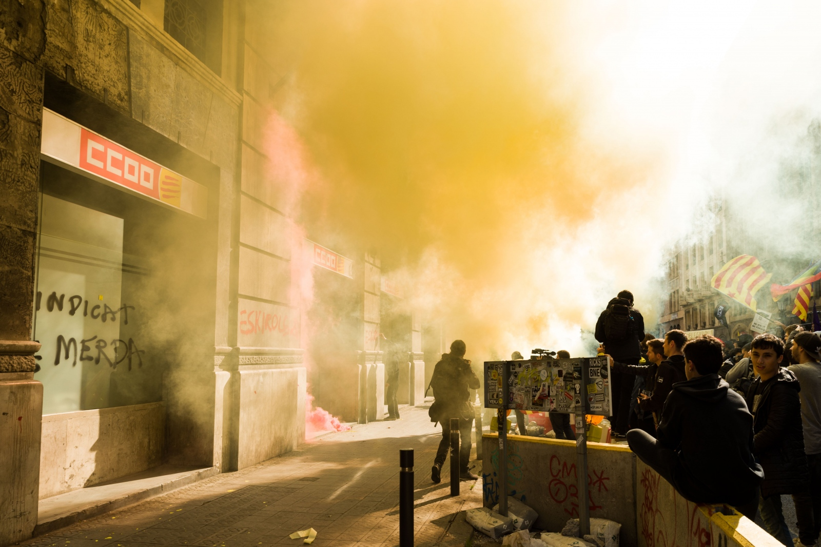 """Some protesters at the general strike in Barcelona threw paint, eggs and smoke bombs against the building of Spain's biggest labor union federation, Comisiones Obreras (CCOO). The spray paint on its walls and doors translates to """"union of shit"""" (sindicat de merda) and """"blackleg"""" (eskirols). The strike had been convoked by the separatist CSC union and protested the trial of Catalonia's secessionist leaders, CCOO jointly with other unions had not supported it. Barcelona, February 16, 2019."""