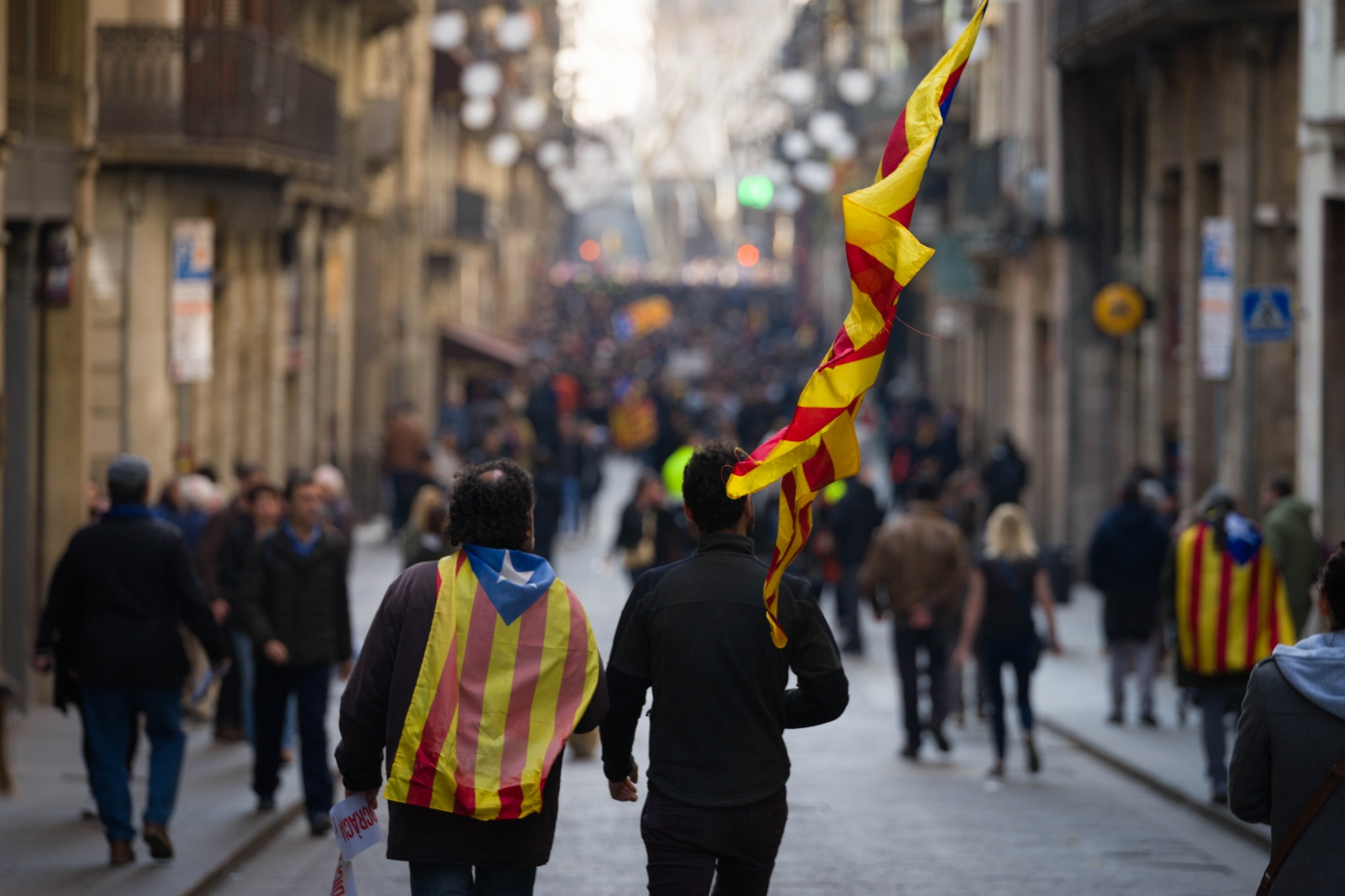 Two protesters join the demonstration of the general strike in Carrer de Ferran, Barcelona. Strikers all over Catalonia were protesting the ongoing Supreme Court trial of their separatist leaders. Barcelona, February 21, 2019.