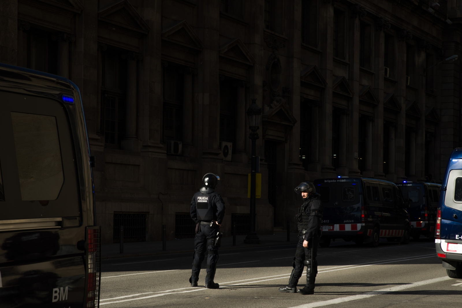 Policemen guard the meeting of the Spanish cabinet in Via Laietana. The meeting that usually takes place in Madrid drew heavy protests from Catalan separatists. It was protected by around 10.000 police forces of the Catalan as well as the Spanish national police that clashed on various occasions with protesters. According to the newspaper El País, at least 13 people were arrested. Barcelona, December 21, 2018.