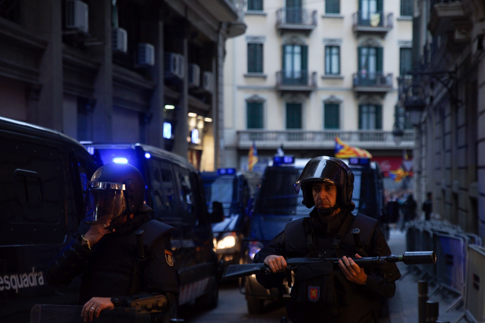 On the first anniversary of the Catalonian referendum on independence, policemen protect a side street of the seat of the Spanish national police in Barcelona. Barcelona, October 1, 2018.