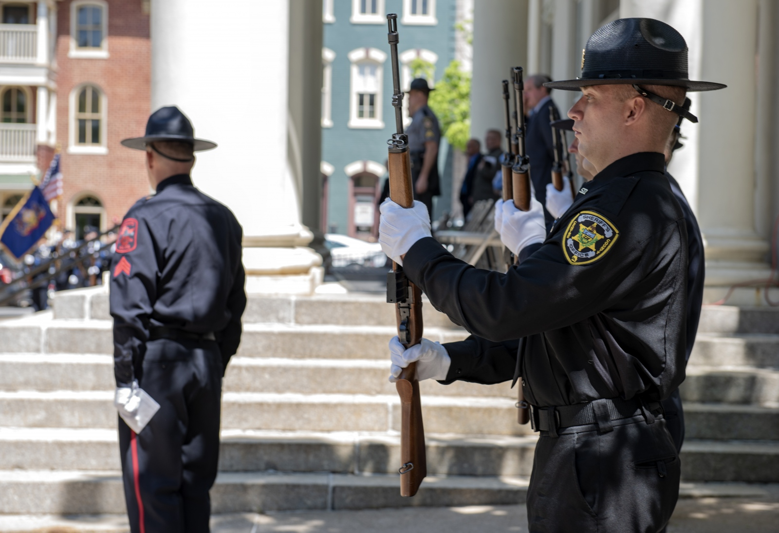 Law enforcement officers stand in line Wednesday during the annual Centre County Law Enforcement Memorial ceremony at the Centre County Courthouse in Bellefonte, May 15, 2019.