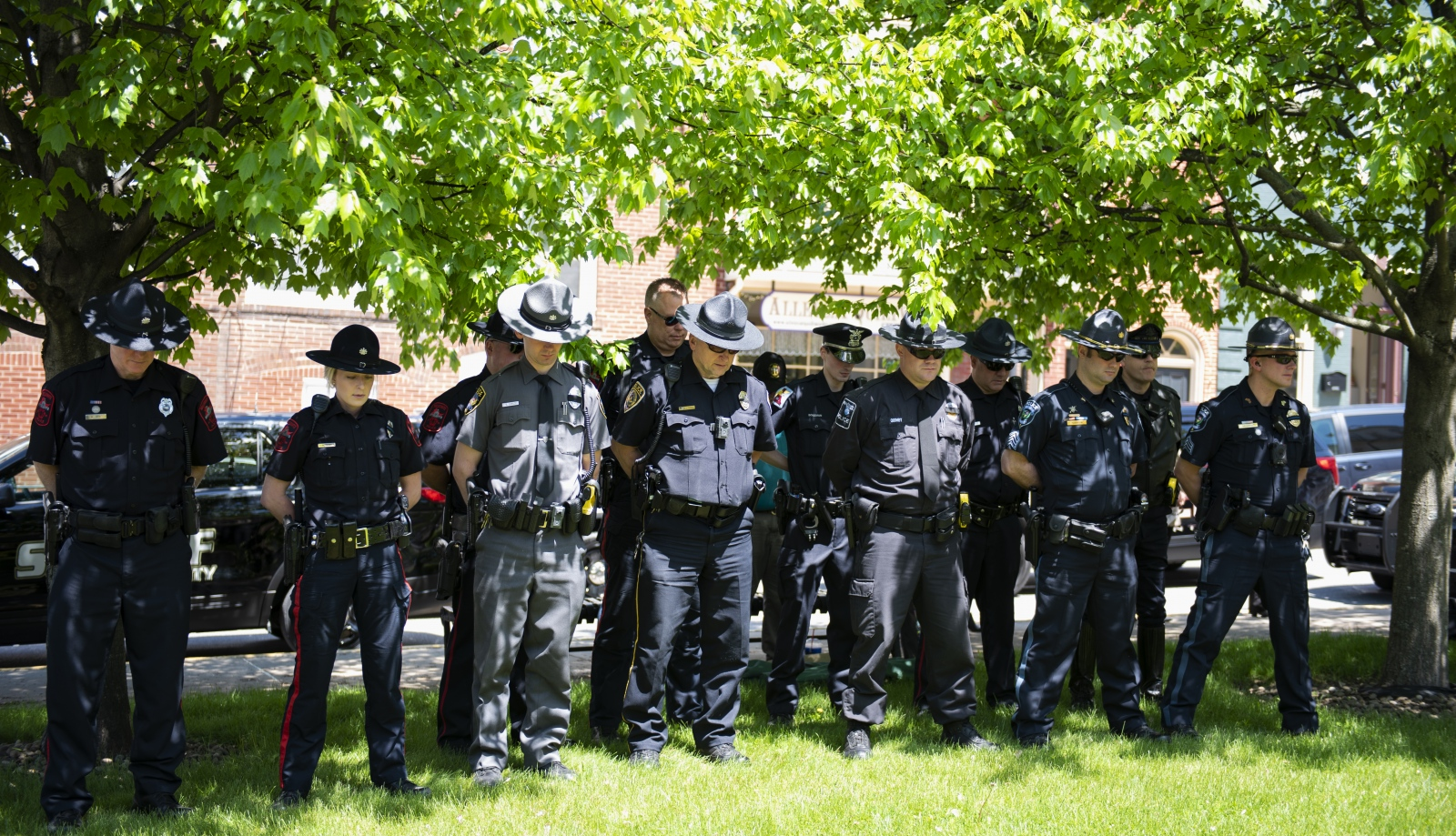 Police officers listen to the speaker at the annual Centre County Law Enforcement Memorial ceremony at the Centre County Courthouse in Bellefonte on Wednesday, May 15, 2019.