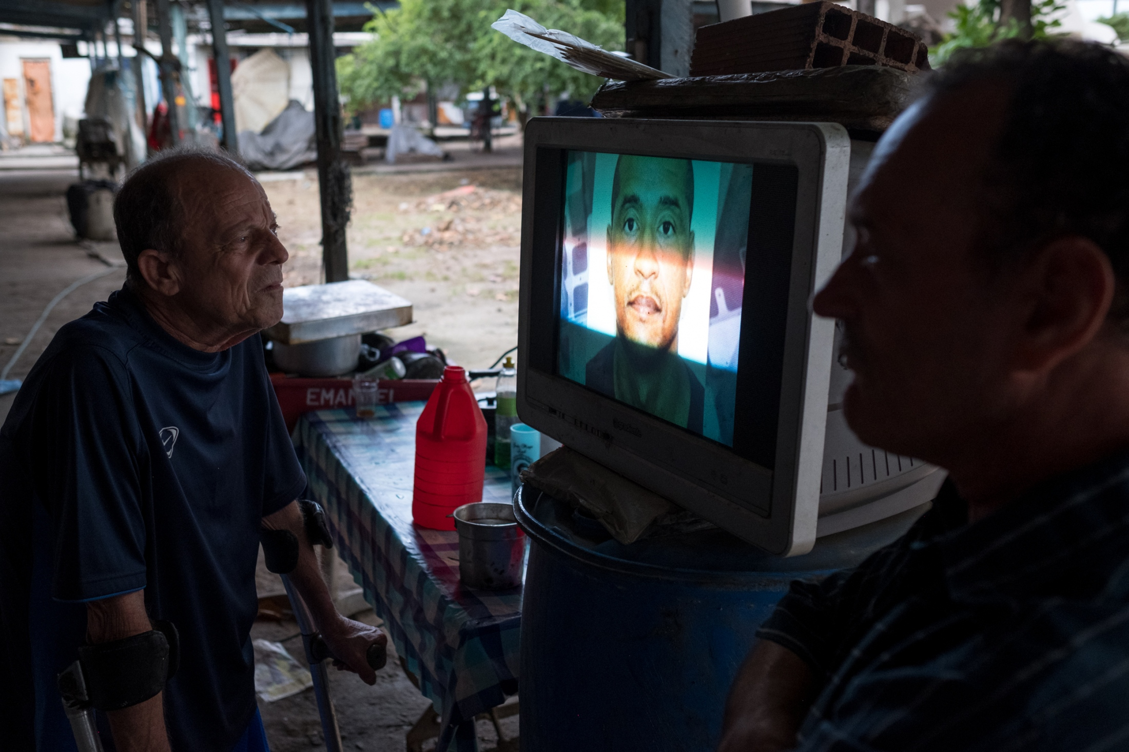 Luis and listens close to the television for a report on a man who lives nearby and was alleged to have murdered his sister and thrown her body in the Guanabara bay. As well as being polluted by sewage and industry the bay is also a deposit for the remains of victims of the violence that plagues Rio and Brazil.