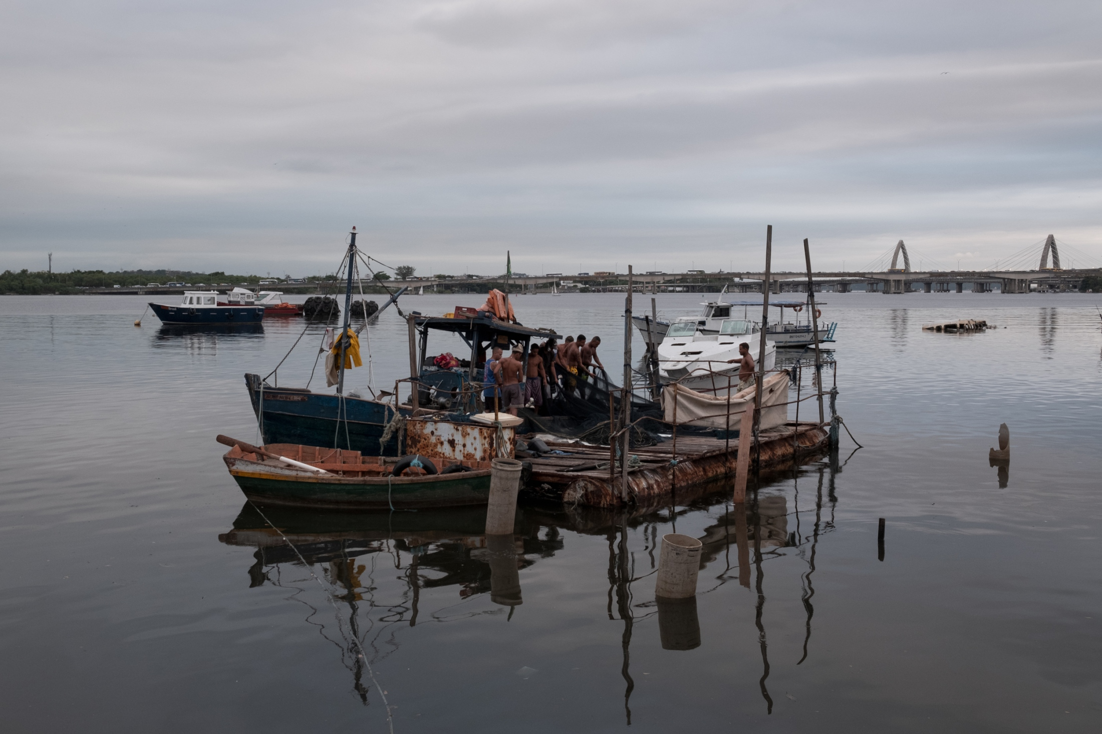 Luis' boat being prepared in its moorings for another night of fishing.