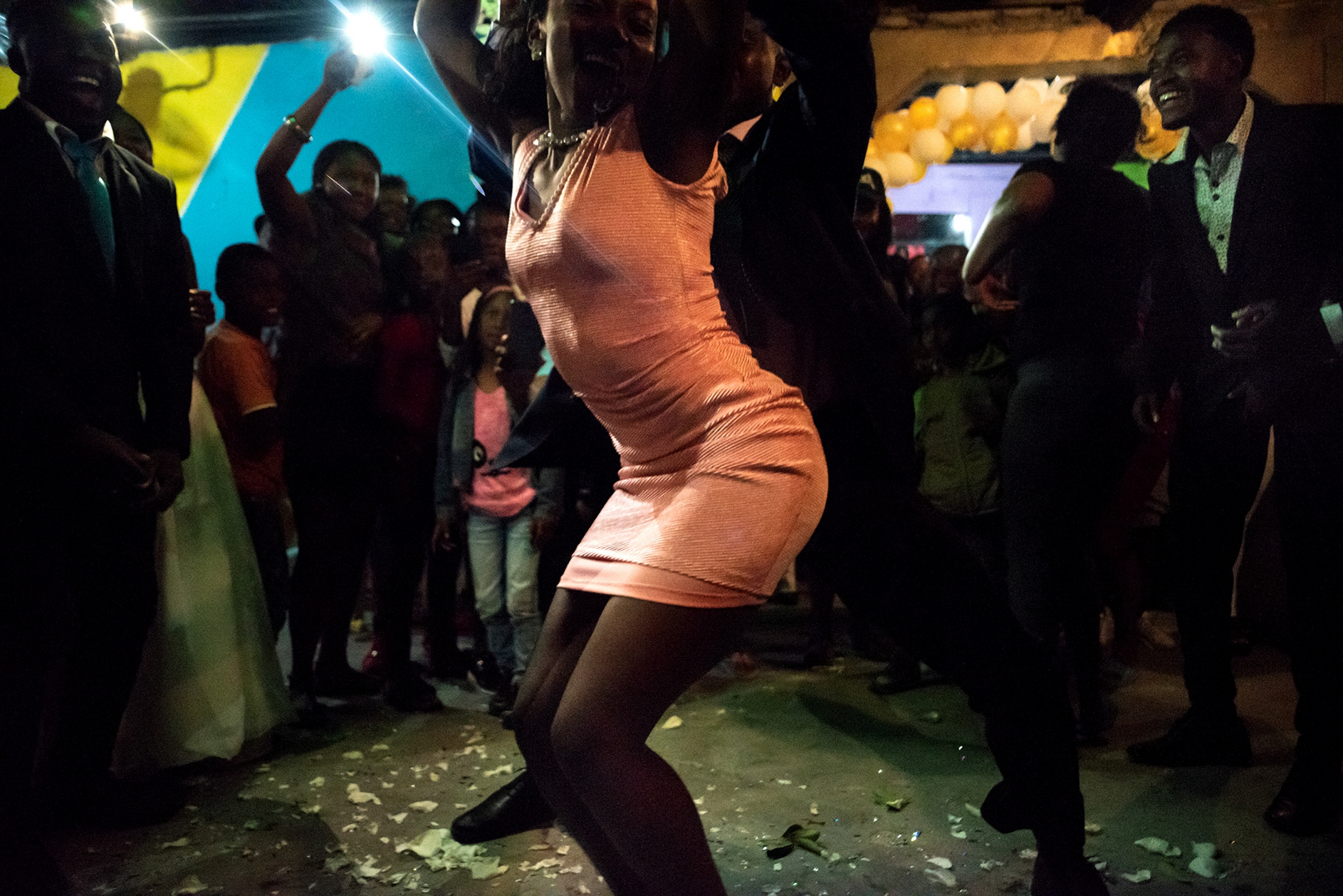 Revelers at a wedding reception. Juncal, Ecuador, 2018.  Johis Alarcón