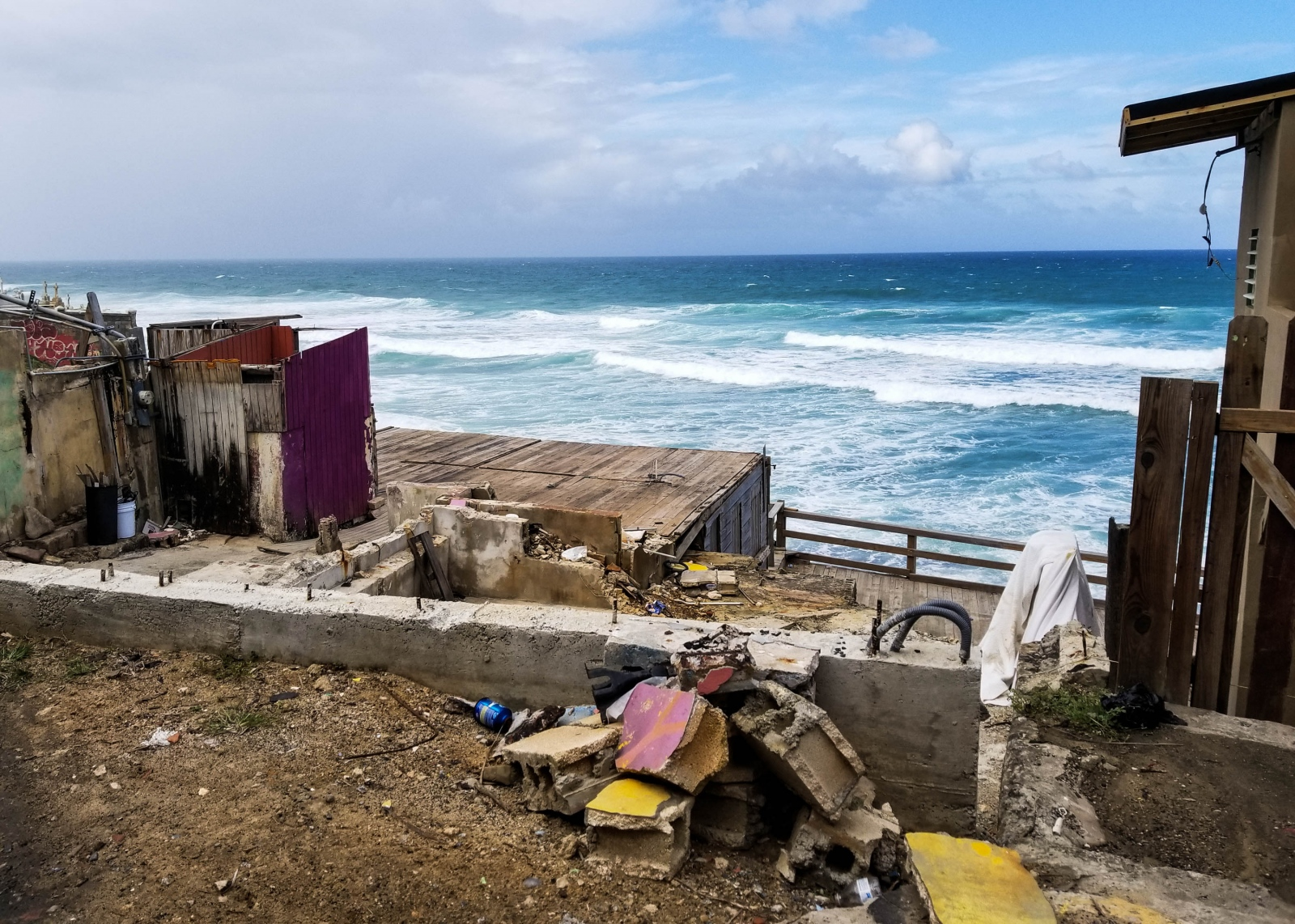 Over a year after Hurricane María, homes continue to be in ruins on the shores of San Juan, Puerto Rico.