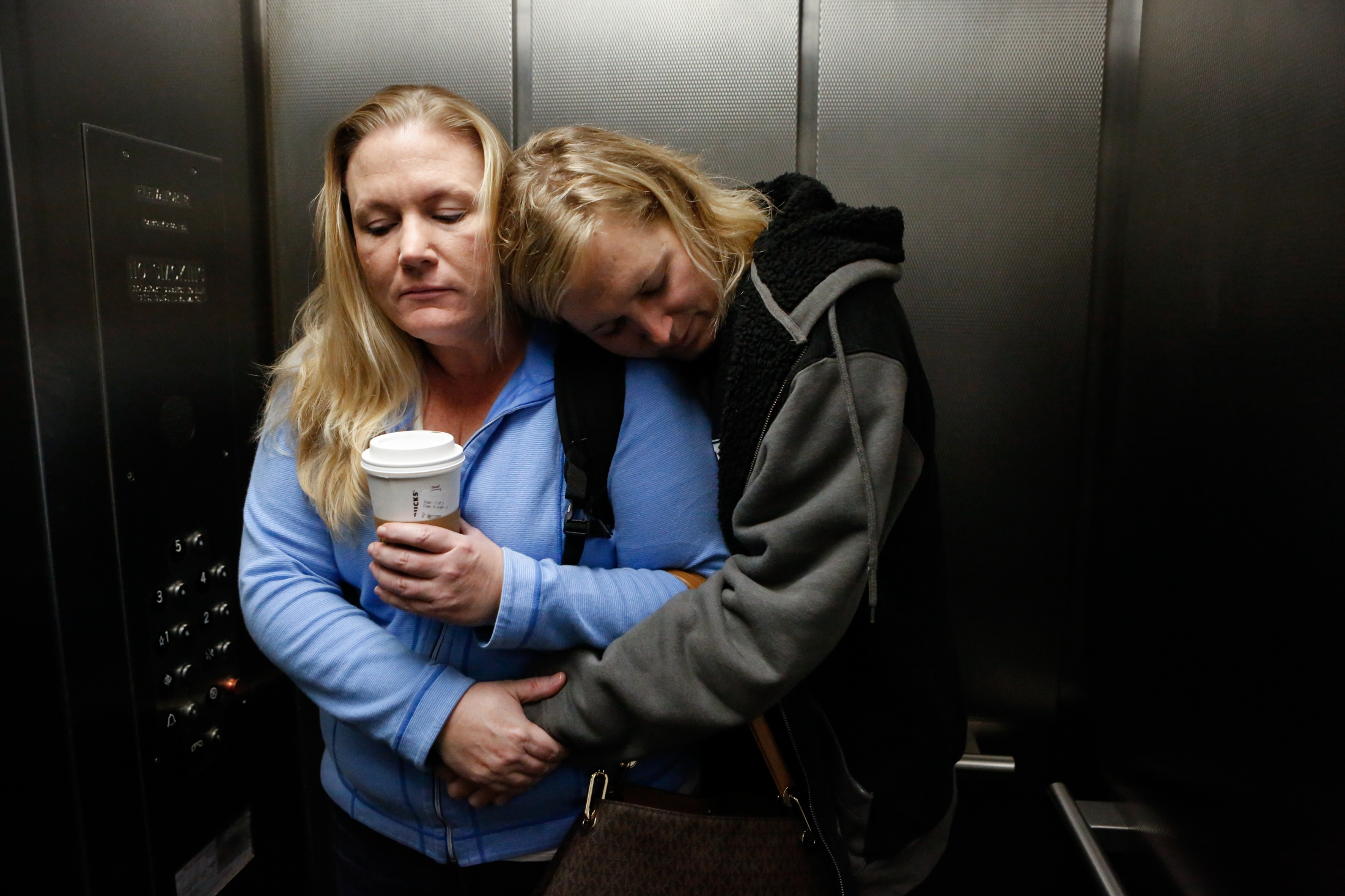 Jenny holds Taylor as they ride the hospital elevator up to check in for Taylor's gender reassignment surgery in January 2018.